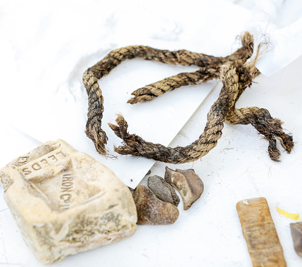 A range of materials are shown such as a piece of string, a soap which has Leeds embossed into it and few stones