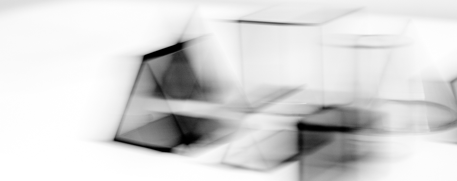 A collection of glass objects are shown in a black and white image