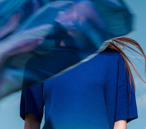 A blue dress is shown in close detail