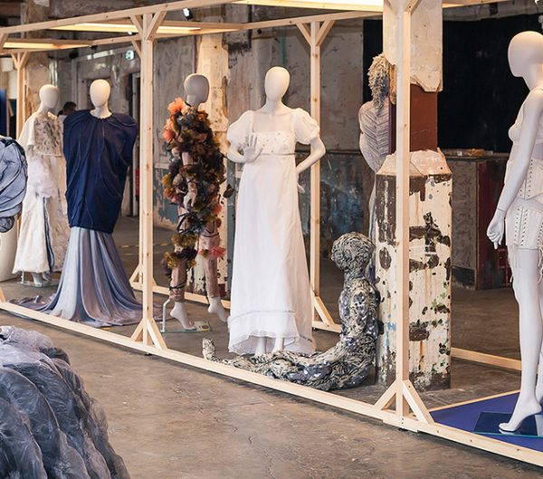 A collection of garments shown in an exhibition space